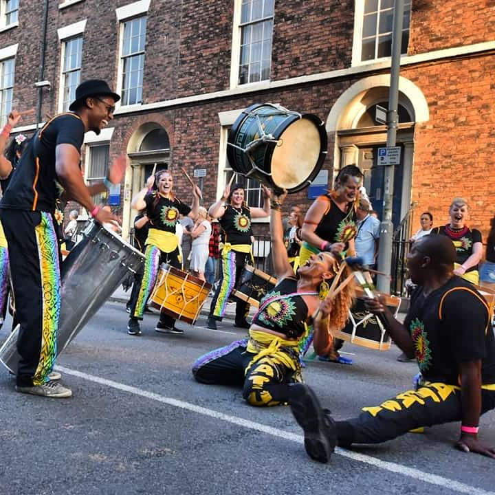 Drummers dancing doing the splits carnival parade
