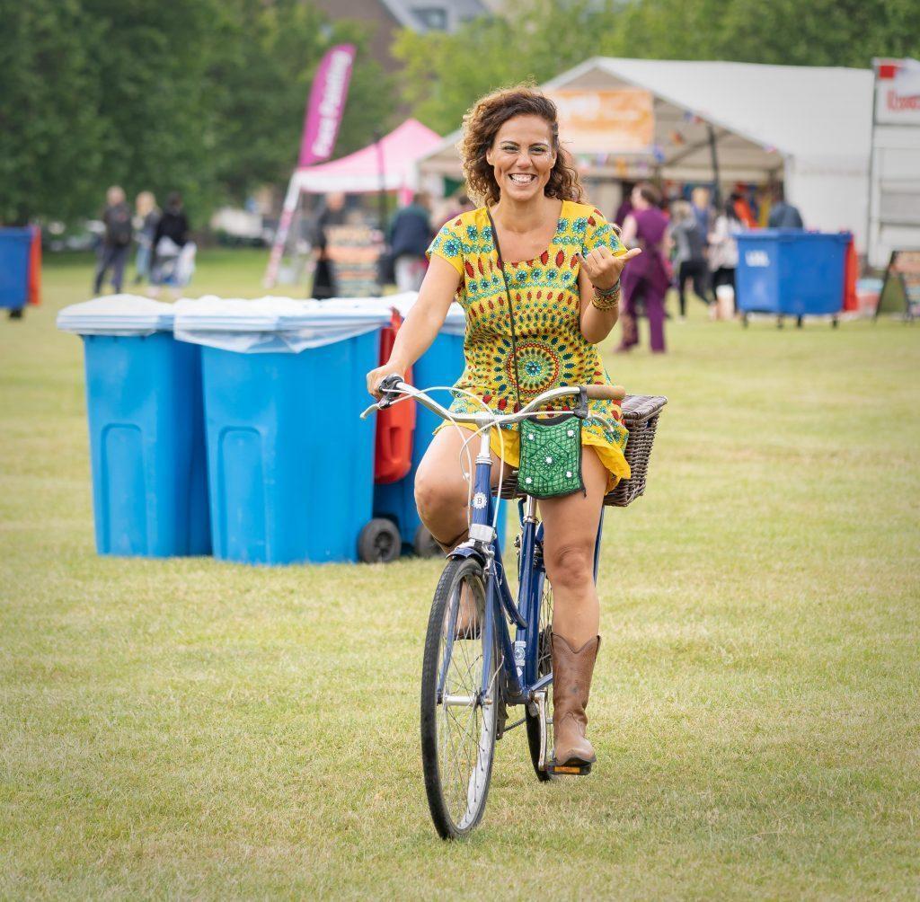 woman on bike colourful dress